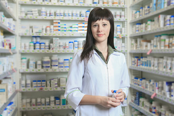 A Woman pharmacist at the pharmacy place