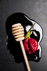 honey & red pepper on black
