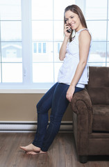 A Portrait  of a beautiful young woman, talking on the phone