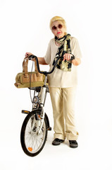 elderly lady with a bicycle