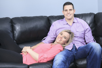 A Couple at home relaxing in sofa