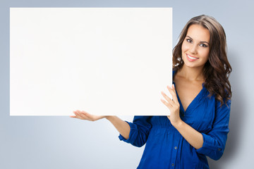 Young woman showing blank signboard