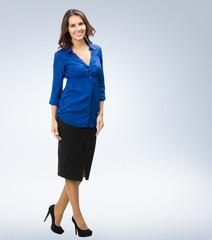 Full body of happy businesswoman