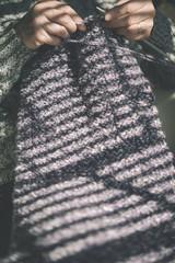 woman sitting on settee knitting