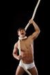 Brawny man strangles himself with rope