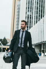 Elegant Businessman Walking in an Office Area with a Motorbike H