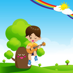 Cute Little boy child playing a music guitar on tree