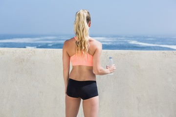 Fit blonde holding water bottle