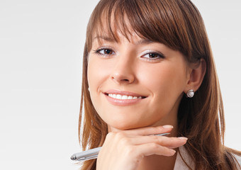 Happy smiling businesswoman with pen