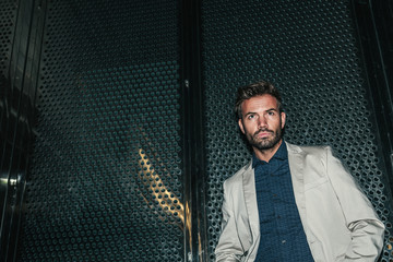Young Sexy Man Against a Metallic Wall