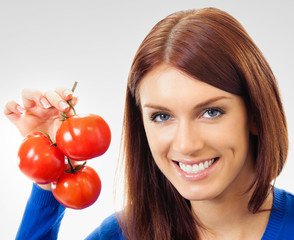 Cheerful woman with tomatoes