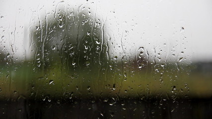 glass windows in the village with raindrops
