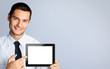 Businessman showing blank tablet pc