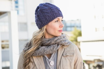 Portrait of blonde in warm clothes thinking