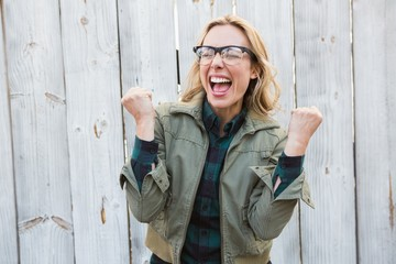 Blonde in glasses shouting and cheering