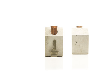 Conceptual Key and Miniature Houses on White