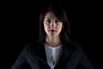 Portrait of serious brunette business woman