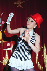 Circus artist woman magician in the glow of spotlight