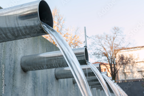 Water flowing out from steel pipes - 78065369
