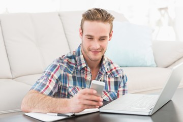 Smiling text messaging and using laptop