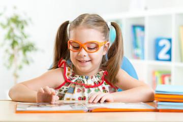 Little girl reading a book