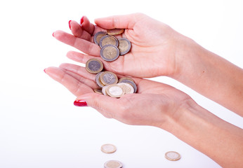Female hand holding euro coin