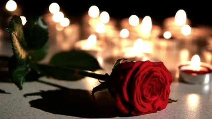 Romantic atmosphere : candles with rose