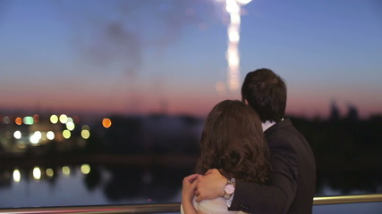 The loving couple watches fireworks