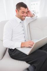 Smiling man on a laptop