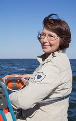 Elderly woman yachtsman on a sailing yacht