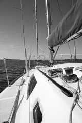 Monochrome picture view on deck of sailing yacht