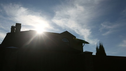 Sun over a roof of the big family house. Sequence 2 shot