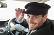 Handsome chauffeur smiling at camera - 78067337
