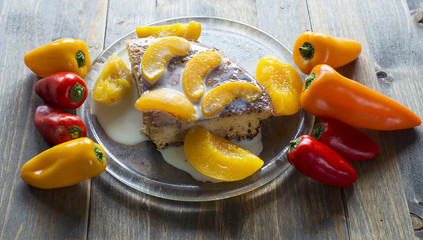 Dessert cake with peaches and pepper