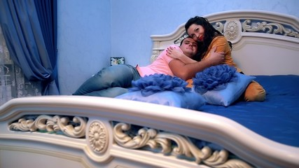 Elevated view of young happy  couple  in bed