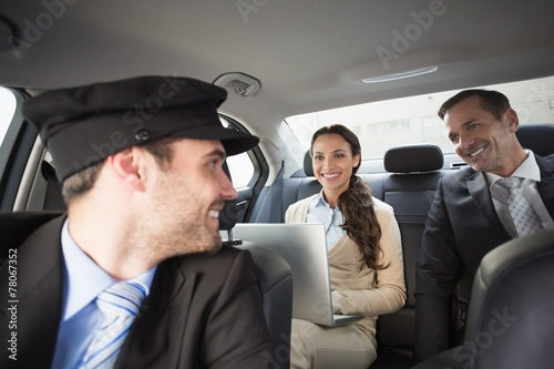 Handsome chauffeur smiling at clients - 78067352