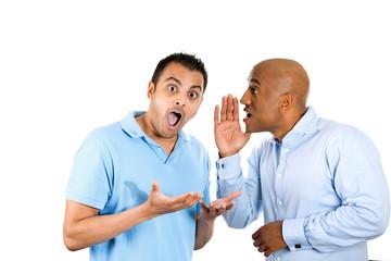 guy whispering into man's ear telling him something secret
