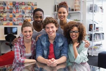 Fashion students smiling at camera together