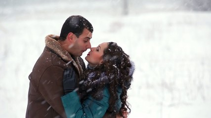 Happy man and woman on snow
