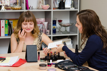 Girl gets foundation for consultations makeup artist