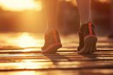 Fototapeta women's feet at the start of the race. concept, sunset