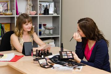 Makeup artist advises office employee