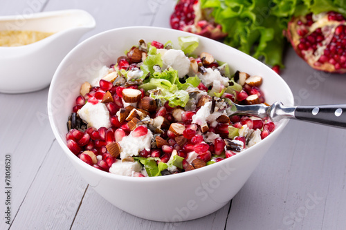 Fotobehang Salade Healthy salad with pomegranate seeds, almond, feta cheese and
