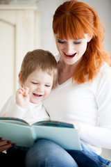 Mom reading her son book