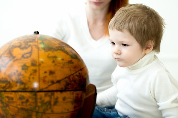 Baby playing with earths globe