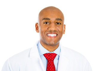 Headshot smiling physician posing with lab coat