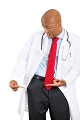 Broke stressed male doctor showing empty pocket