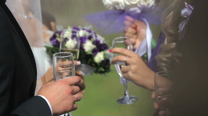 People communicate on a banquet with glasses in hands.