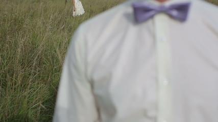 Loving couple walking in a field