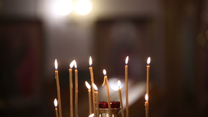 Burning candles in the Orthodox Church